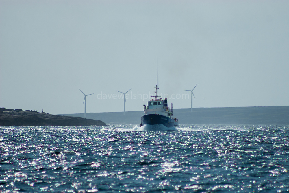 """Windfarm on Inishmore, Aran Islands, Ireland. The Aran Islands are amongst 26 EU islands which officially launched their clean energy transition  in February 2019. The Aran Islands are dependent on expensive and polluting fuels for electricity production, heating and transport, and is connected to the national grid. A fault in the line in 2016 underlined  the islands' energy dependency which re-ignited conversation about carbon-neutrality and renewable energy generation.<br /> <br /> """"The objective of the Clean Energy for EU Islands Secretariat is to help as many European islands as possible embark on and advance their clean energy transition in a way that includes the whole island and its stakeholders. Based on experience with successful transition processes, the key to success is to involve all levels of governance of the islands - citizens, municipalities, local businesses, universities and schools – as well as relevant stakeholders from the mainland and bring them on board to actively support and shape their own transition.""""<br /> https://ec.europa.eu/info/news/26-european-islands-launch-clean-energy-transition-2019-feb-18_en"""