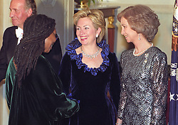 Actress Whoopi Goldberg, left, is greeted by First Lady Hillary Rodham Clinton, center, as she passes through the receiving line in the Grand Foyer of the White House prior to the State Dinner honoring the Queen and King Juan Carlos I of Spain on February 23, 2000 in Washington, D.C. Queen Sofia of Spain, right, looks on. Photo by Ron Sachs/CNP/ABACAPRESS.COM