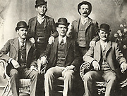 The Wild Bunch, 1901, gang of American outlaws, bank and train robbers, led by Butch Cassidy, seated right. Cassidy, born Robert LeRoy Parker (1866-1908): Standing left, William Carver (1866-1901): Standing right, Harvey Logan alias Kid Curry (1867-1904) cowboy and gunman: Seated left, Harry Alonzo Longbugh or Longbaugh (1867-1908) alias The Sundance Kid:  Seated centre, Ben Kilpatrick (1874-1912).