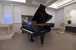 An Imperial Bosendorfer concert grand piano, played by Queen, Coldplay, Robbie Williams and Talk Talk on display ahead of the the Entertainment Memorabilia Sale at Bonhams in Knightsbridge, London later this week.