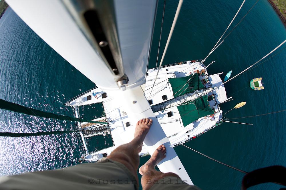 Self portrait from mast of catamaran while sailing in the Galapagos Islands, Ecuador.