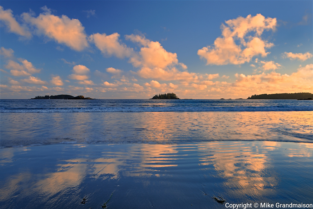 CLouds reflecting in Pacific Ocean at Long Beach at sunrise<br /> Pacific Rim National Park<br /> British Columbia<br /> Canada