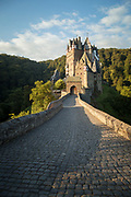 View of the bridge leading to Eltz Castle, a medieval castle nestled in the hills above the Moselle River between Koblenz and Trier, Germany.