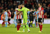 Sheffield United's Dean Henderson embraces Phil Jagielka (left) as they celebrate at the final whistle<br /> <br /> Photographer Rich Linley/CameraSport<br /> <br /> The Premier League - Sheffield United v Burnley - Saturday 2nd November 2019 - Bramall Lane - Sheffield<br /> <br /> World Copyright © 2019 CameraSport. All rights reserved. 43 Linden Ave. Countesthorpe. Leicester. England. LE8 5PG - Tel: +44 (0) 116 277 4147 - admin@camerasport.com - www.camerasport.com