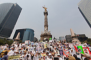 """Mothers of disappeared people from states of Coahuila, Nuevo León, Chihuahua, Guanajuato, Veracruz, Querétaro, Jalisco, Estado de México and Mexico City made the """"Second March of Dignity"""" on May 10th, 2013, Mothers Day, to the Angel de la Independencia demanding results on the investigations. Human Rights Watch reported on February 2013 that, in 149 from 250 documented cases, state agents were involved during the administration of ex-president Felipe Calderón. New Enrique Peña Nieto's administration announced actions, with still no results. (Photo: Prometeo Lucero)"""