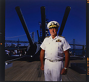 Admiral of the Pacific Fleet (CinCPac, ret.) James Lyons, with a ship's 16 inch guns behind him. (He retired as 4 star).