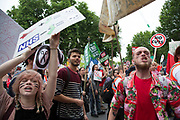 London, UK. Saturday 20th June 2015. People's Assembly against austerity demonstration through Central London. 250,000 people gathered to protest in a march through the capital protesting against the Tory cuts, holding placards and banners. People shouting towards Downing St.