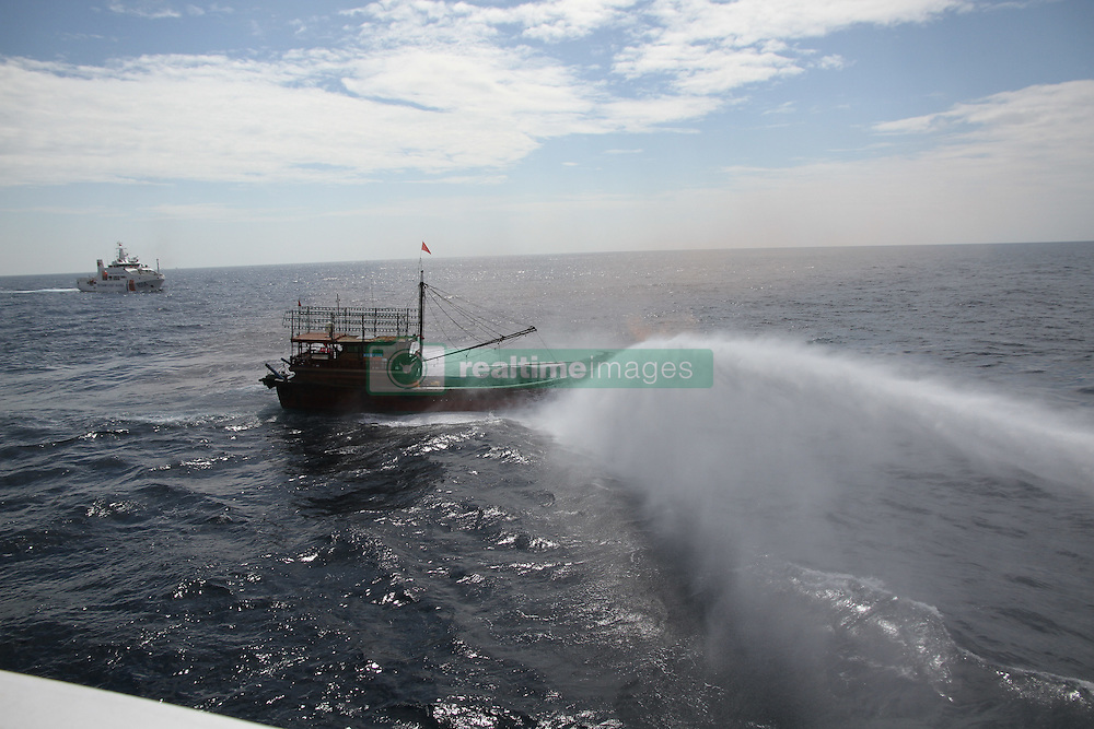 HAIKOU, Nov. 9, 2016 (Xinhua) -- Coast guards from China and Vietnam put out fire in a drill in a common fishing zone in the Beibu Gulf, Nov. 7, 2016. China and Vietnam concluded a three-day joint patrol mission in a common fishing zone in the Beibu Gulf Wednesday. Coast guards from both sides completed a series of scheduled tasks, including a joint patrol, maritime search and rescue exercise, and examination of fishing boats, amid strong winds and high waves, according to a China Coast Guard (CCG) statement. (Xinhua/Bai Guolong) (zkr) (Credit Image: © Bai Guolong/Xinhua via ZUMA Wire)