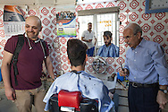 Mahmoud Hassino, organiser of Mr Gay Syria, accompanies Hussein, the contest winner, to a barber shop in Istanbul for an attempted new look.