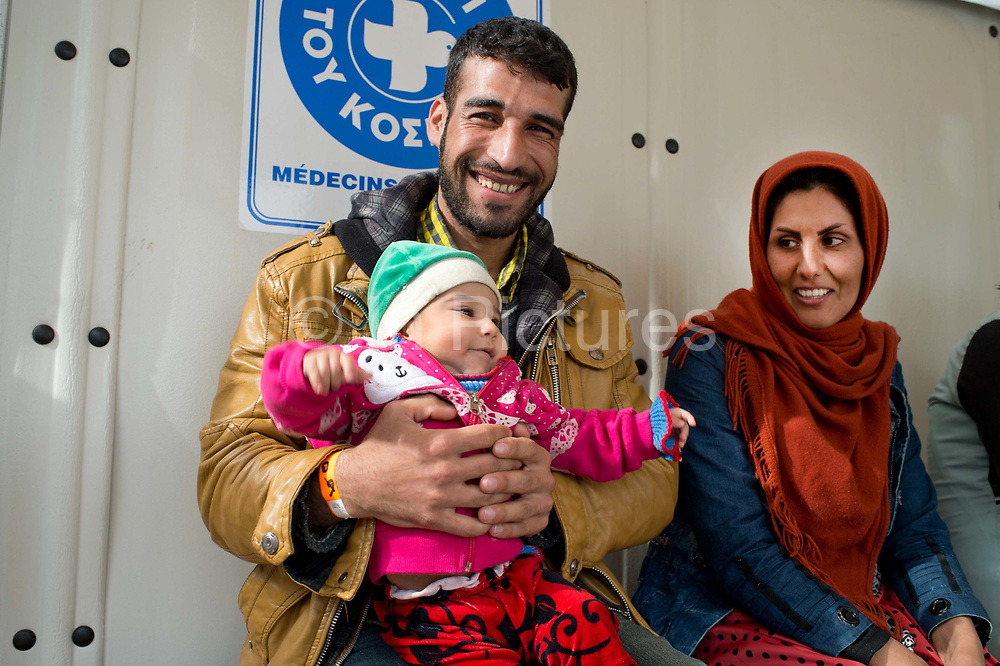 Greece with Doctors of the World (Medecins du monde). Chios Island, one of the places where refugees from Turkey land en route to Northern Europe. Souda camp. MDM clinic .Sabina , 6 month old baby who is  teething. Her mother is Amineh Arma aged 24.
