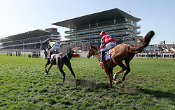 Might Bite ridden by Nico de Boinville (left) taking the lead in the RSA Novices' Chase during Ladies Day of the 2017 Cheltenham Festival at Cheltenham Racecourse