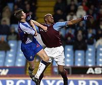 Copyright Sportsbeat. 0208 3926656<br />Picture: Henry Browne<br />Date: 2/2/2003<br />Aston Villa v Blackburn Rovers FA Barclaycard Premiership<br />Dion Dublin of Villa fends off Blackburn's Nils - Eric Johansson