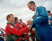 Pilot of the Red Arrows, Britain's RAF aerobatic team handshakes his dedicated engineer at the end of display season.