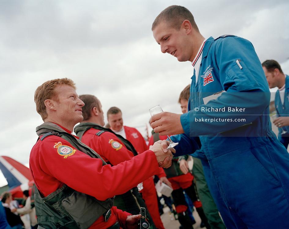 Pilot of the Red Arrows, Britain's RAF aerobatic team handshakes his dedicated engineer at the end of display season.