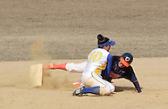 Middletown, NY - Nicole Trifono of SUNY Orange slides into second base as Danielle DePasquale of Gloucester County College makes the tag during a women's softball game on March 30, 2008.