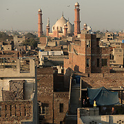 View from the roofs of the Walled City of Lahore. Distant view of the Badshahi Mosque.