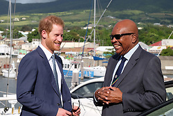 RETRANSMITTED CORRECTING CAPTION<br /> Kensington Palace handout photo of Prince Harry with Governor-General of Saint Kitts and Nevis Sir Tapley Seaton at the grave of Sir Thomas Warner, the first Governor-General of St Kitts and Nevis after arriving on the island of St Kitts for the second leg of his Caribbean tour.