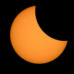 The Moon is seen passing in front of the Sun during a solar eclipse from Ross Lake, Northern Cascades National Park, Washington on Monday, Aug. 21, 2017. A total solar eclipse swept across a narrow portion of the contiguous United States from Lincoln Beach, Oregon to Charleston, South Carolina. A partial solar eclipse was visible across the entire North American continent along with parts of South America, Africa, and Europe.  Photo Credit: NASA/Bill Ingalls<br /> <br /> NASA eclipse info: eclipse2017.nasa.gov  Please note: Fees charged by the agency are for the agency's services only, and do not, nor are they intended to, convey to the user any ownership of Copyright or License in the material. The agency does not claim any ownership including but not limited to Copyright or License in the attached material. By publishing this material you expressly agree to indemnify and to hold the agency and its directors, shareholders and employees harmless from any loss, claims, damages, demands, expenses (including legal fees), or any causes of action or allegation against the agency arising out of or connected in any way with publication of the material.