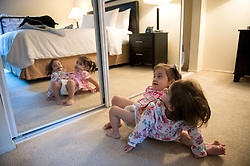 Oct 8, 2016 - Palo Alto, California, U.S. - Erika and Eva Sandoval see their reflection in a mirrored closet door while moving into a new apartment. Aida relocated to be closer to the Lucile Packard Children's Hospital while the conjoined twins underwent several months of gradual tissue expansion for their upcoming separation surgery. (Credit Image: © Lezlie Sterling/Sacramento Bee via ZUMA Wire)