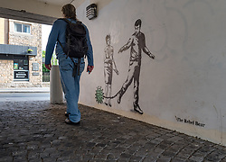 Canongate, Edinburgh, Scotland, United Kingdom, 10th June 2021. New Rebel Bear graffiti: new graffiti appearing to depict Nicola Sturgeon with bolt cutters with a man chained to Coronavirus, referencing the ending of pandemic restrictions appeared last night near the Scottish Parliament. <br /> Sally Anderson | EdinburghElitemedia.co.uk