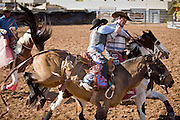02 NOVEMBER, 2008 -- PHOENIX, AZ: A competitor finished his ride at the Arizona High School Rodeo at the Arizona State Fair in Phoenix. Teams from across the state participate. The Arizona High School Rodeo Association sponsors a full season of high school rodeo that culminate in a championship rodeo in June.  PHOTO BY JACK KURTZ