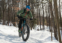 "A fat bike rider takes to the groomed trails at Highlands Mountain Bike Park on Saturday during the 50th anniversary ""then and now"" celebration.  (Karen Bobotas/for the Laconia Daily Sun)"