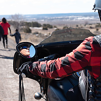 Sylvia Clifford, 53, of Shiprock, rides her motorcycle south on Indian Route 12 with the walking group, as they raise awareness for the Missing and Murdered Indigenous Women and Girls Walk in Window Rock Friday.