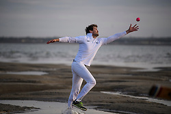 © Licensed to London News Pictures. 24/08/2017. Solent, UK. A fielder attempts to catch the ball .Teams take part in the Brambles Bank Cricket Match in the middle of The Solent strait on August 24, 2017. The annual cricket match between the Royal Southern Yacht Club and The Island Sailing Club, takes place on a sandbank which appears for 30 minutes at lowest tide. The game lasts until the tide returns. Photo credit: Ben Cawthra/LNP
