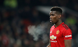 """Manchester United's Paul Pogba during the Premier League match at Old Trafford, Manchester. PRESS ASSOCIATION Photo. Picture date: Tuesday January 29, 2019. See PA story SOCCER Man Utd. Photo credit should read: Martin Rickett/PA Wire. RESTRICTIONS: EDITORIAL USE ONLY No use with unauthorised audio, video, data, fixture lists, club/league logos or """"live"""" services. Online in-match use limited to 120 images, no video emulation. No use in betting, games or single club/league/player publications"""