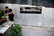 Construction site of new housing development One Athens in Kolonaki. ONE ATHENS is a revolutionary new concept for living in downtown Athens. Housed in an iconic landmark in Kolonaki, with an unrivalled location and view, with exclusive access to a full spectrum of five-star facilities, with just 25 individually designed residences to suit every lifestyle, ONE ATHENS raises the standard of luxury living in the heart of the city. Athens is the capital and largest city of Greece. It dominates the Attica periphery and is one of the world's oldest cities, as its recorded history spans around 3,400 years. Classical Athens was a powerful city-state. A centre for the arts, learning and philosophy.