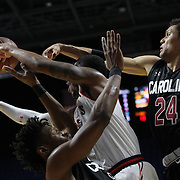 Ron Mvouika, St. John's, gets the ball away while challenged by Chris Silva, (left), and Michael Carrera, (right), South Carolina, during the St. John's vs South Carolina Men's College Basketball game in the Hall of Fame Shootout Tournament at Mohegan Sun Arena, Uncasville, Connecticut, USA. 22nd December 2015. Photo Tim Clayton
