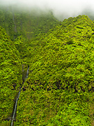 Aerial view of Namolokama Falls, Kauai, Hawaii on a cloudy day.