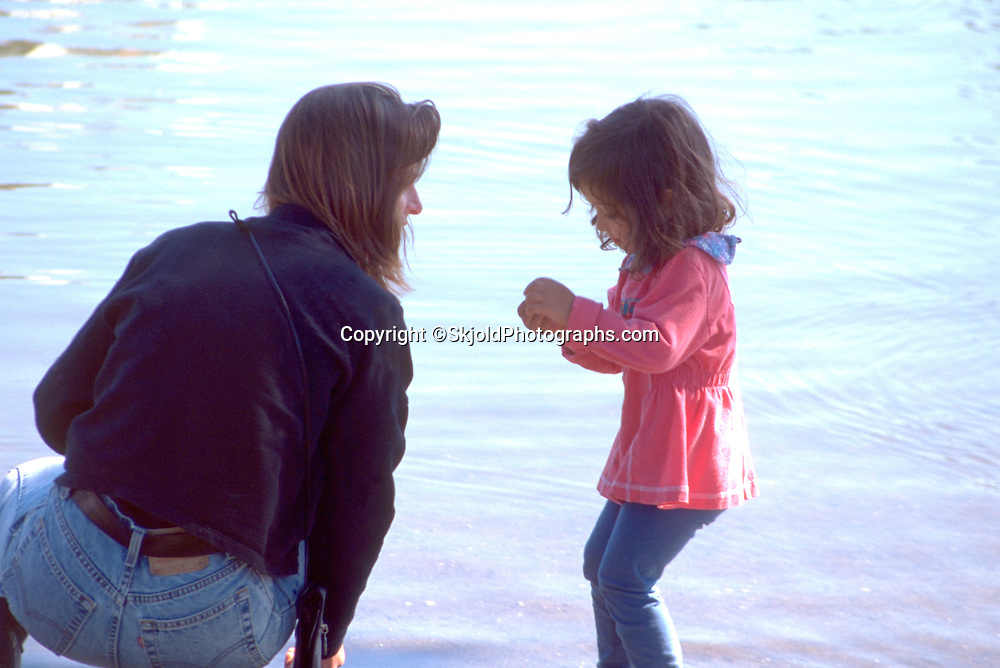 Asian daughter playing in Loring Pond age 25 and 3. Ben and Jerrys One World One Heart Festival Minneapolis Minnesota USA