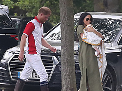 The Duke and Duchess of Sussex with their son Archie as they the King Power Royal Charity Polo Day at Billingbear Polo Club, Wokingham, Berkshire.