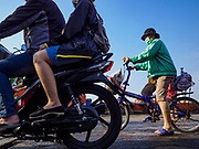 22 JANUARY 2019 - PHRA PRADAENG, SAMUT PRAKAN, THAILAND:  Passengers disembark from a motorcycle and vehicle ferry that crosses the Chao Phraya River in Phra Pradaeng. The use of vehicle ferries across the river has gone down as the government has built bridges to connect communities on both sides of the river. The Phra Pradaeng ferries are the busiest vehicle ferries in the Bangkok metropolitan area. Since the BTS Skytrain now comes close to the ferry, the number of commuters going into Bangkok that use the ferry has increased.    PHOTO BY JACK KURTZ
