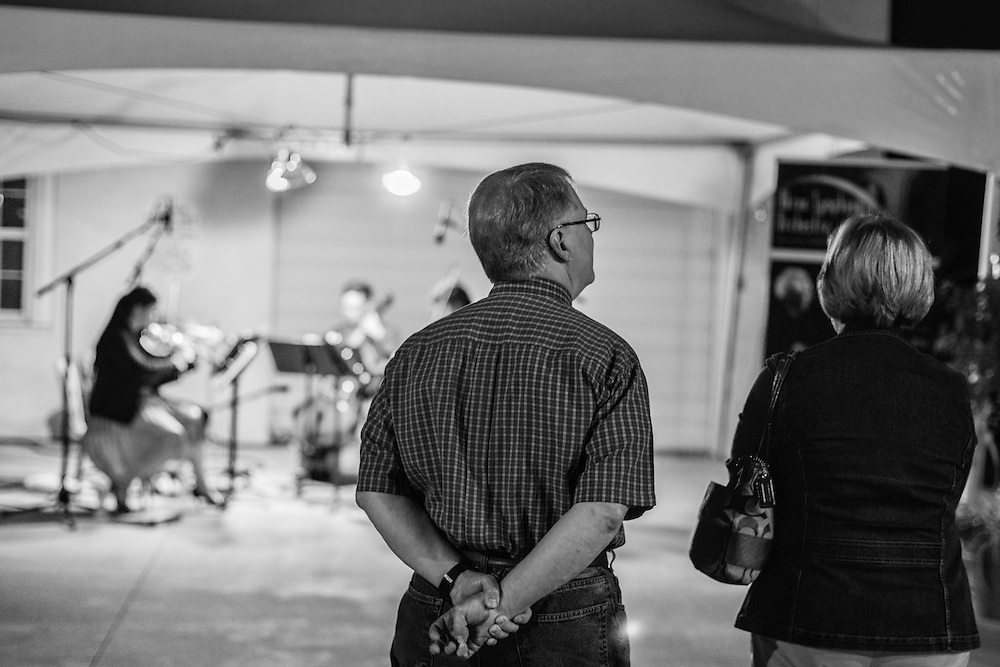 Residents listening to a performance by an Akron Symphony string quartet at the NorthSide district during Akron Art Prize 2014.