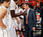 CHARLOTTESVILLE, VA- DECEMBER 6: Head coach Tony Bennett of the Virginia Cavaliers with players during the game on December 6, 2011 at the John Paul Jones Arena in Charlottesville, Virginia. Virginia defeated George Mason 68-48. (Photo by Andrew Shurtleff/Getty Images) *** Local Caption *** Tony Bennett