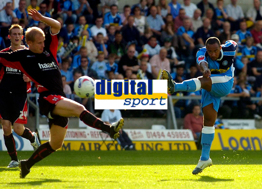 Photo: Alan Crowhurst.<br />Wycombe Wanderers v Lincoln City. Coca Cola League 2. 23/09/2006. Chris Palmer of Wycombe (R) shoots at goal.