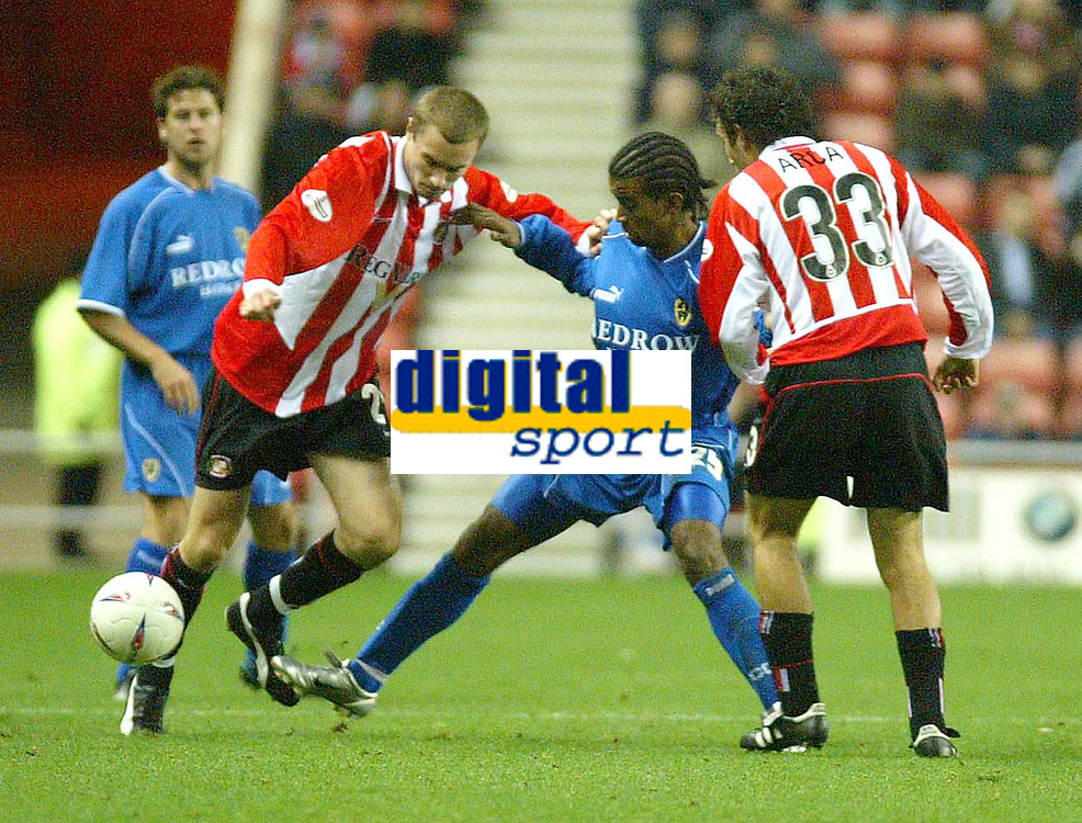 Photo. Andrew Unwin<br /> Sunderland v Cardiff City, Nationwide League Division One, Stadium of Light, Sunderland 14/10/2003.<br /> Cardiff's Richard Langley (c) fights for the ball with Sunderland's Colin Healy (l) and Julio Arca (r).