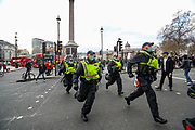 Police officers use charge against protestors during clashes following a 'Kill the Bill' protest in Trafalgar Square central London on Saturday, April 3, 2021. Projectiles were thrown as police pushed protesters away, and dozens of extra officers were brought in to help unblock the road for a McDonald's lorry held up outside parliament. (Photo/ Vudi Xhymshiti)