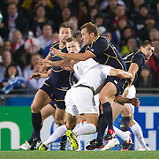 Dan Parks, Scotland, is tackled during the England V Scotland Pool B match during the IRB Rugby World Cup tournament. Eden Park, Auckland, New Zealand, 1st October 2011. Photo Tim Clayton...