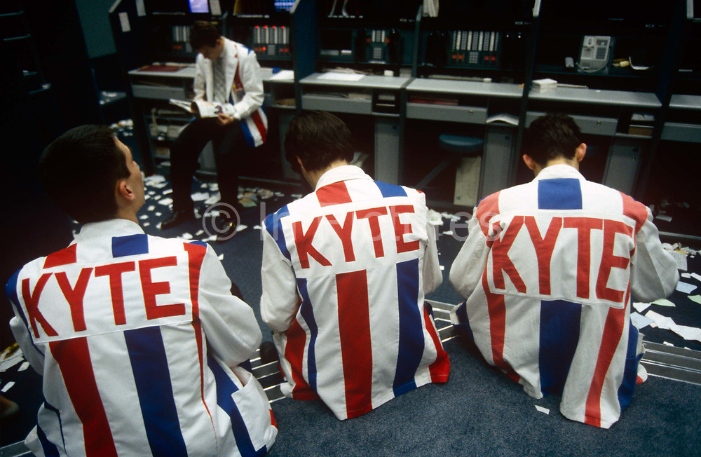 At the end of trading, tired brokers who used the 'open cry' form of communicating futures and commodity prices on the trading floor at the London International Financial Futures Exchange (LIFFE) in the 1990s. The floor is also known as the bear pit where derivatives, options, futures and their contracts are exchanged in a frenzy of arm and hand expressions which communicate prices and quantities. The LIFFE exchange was synonymous with the Thatcherite capitalist money-making ethos in the City of London of the 80s and early 90s before the takeover by Euronext in January 2002. It is currently known as Euronext.liffe. Euronext subsequently merged with New York Stock Exchange in April 2007.