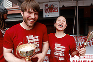 """Photograph of Sonya """"The Black Widow"""" Thomas congratulates Adrian """"The Rabbit"""" Morgan as he takes first place at the Rouses Markets 2014 World Crawfish Eating Contest at French Quarter Fest in New Orleans, LA."""