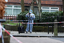 © Licensed to London News Pictures. 26/01/2021. London, UK. A forensics photographer on Holland Walk in Islington, north London taking photographic evidence after a fatal stabbing of a teenage boy. Police were called to Holland Walk on Monday 25 January at approximately 17:30GMT to a report of a stabbing. Officers attended with London Ambulance Service and helicopter emergency medical service (HEMS), and found a teenage boy suffering from a stab injury. Despite efforts by emergency services he was sadly pronounced dead at the scene a short while later. Photo credit: Dinendra Haria/LNP