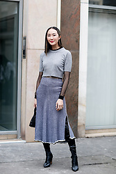 Street style, Chriselle Lim arriving at Altuzarra Fall-Winter 2018-2019 show held at La Coupole, in Paris, France, on March 3rd, 2018. Photo by Marie-Paola Bertrand-Hillion/ABACAPRESS.COM