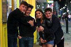 © Licensed to London News Pictures. 02/10/2020. Liverpool, UK. Drinkers enjoy a night out in Liverpool where new lockdown restrictions will be introduced at midnight to limit socialising between household in indoor settings. Photo credit: Kerry Elsworth/LNP