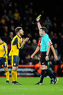 Shkodran Mustafi (20) of Arsenal pleads with referee Michael Oliveras he is shown a yellow card during the Premier League match between Bournemouth and Arsenal at the Vitality Stadium, Bournemouth, England on 3 January 2017. Photo by Graham Hunt.