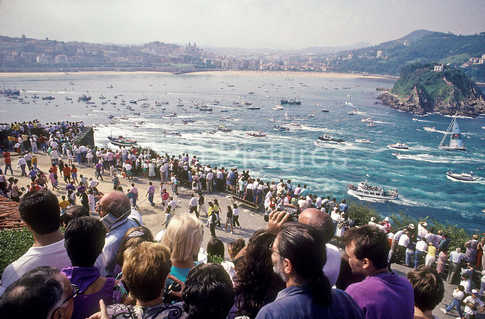 """A flotila of boats take part in the traditional """"Traineras'  boat race in San Sebastian, Basque country, Spain."""