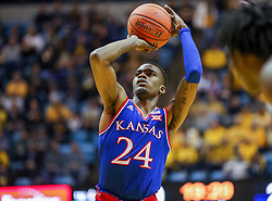 Jan 19, 2019; Morgantown, WV, USA; Kansas Jayhawks guard Lagerald Vick (24) shoots a foul shot during the first half against the West Virginia Mountaineers at WVU Coliseum. Mandatory Credit: Ben Queen-USA TODAY Sports