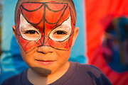 An unidentified boy poses for a portrait after having his face painted with a Spider Man mask during the National Night Out event hosted by Cathedral of Faith Milpitas at Selwyn Park in Milpitas, California, on August 7, 2014. (Stan Olszewski/SOSKIphoto)